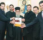 Byzantine Music School members present the first copy of their guide to Archbishop Demetrios - Photo: DIMITRIS PANAGOS.
