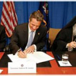 Archbishop Demetrios of America, NY Governor Cuomo, and New York Senator Dean Skelos, sign the agreement to kick-start the rebuilding of St. Nicholas Greek Orthodox Church.