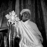 A priest sits before the curtains of an inner sanctum, which in every Ethiopian church houses replicas of the tablets of Moses, supposedly kept within the Ark of the Covenant and known as 'tabots'.  (Image credit: Ralph Bennett Crignola)