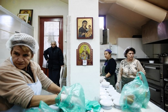 Alkis Konstantinidis for The Wall Street JournalWomen in the Athens suburb of Argyroupolis prepare meals at a church soup kitchen in late November, as church resources are strained by crisis.