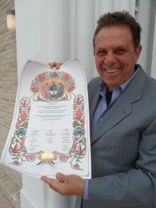 George Matsoukas, OCL Executive Director, proudly holding the Gramota received from the OCA Holy Synod of Bishops.