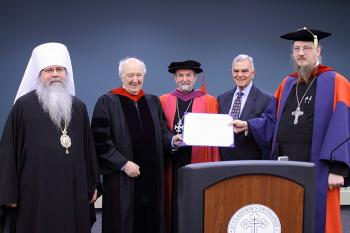 Awarding the honorary doctorate: [L to R] Metropolitan Tikhon, Dr. Peter Brown, Fr. Chad Hatfield, Board Executive Chair Alex Machaskee, Fr. John Behr.