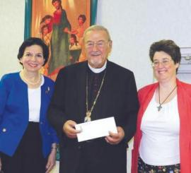 President Violet Robbat and Vice President Dianne O'Regan present check for 2012 project to His Eminence, Metropolitan Philip
