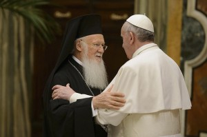 Pope Francis embraces Ecumenical Patriarch Bartholomew of Constantinople, spiritual leader of Orthodox Christians, at the Vatican March 20. The pope met with Patriarch Bartholomew before a meeting with the Christian, Jewish, Muslim, Buddhist, Hindu, Sikh and Jain delegations that had come to the Vatican for his inauguration. (CNS photo/L'Osservatore Romano) (March 20, 2013) See FRANCIS-DIALOGUE March 20, 2013.