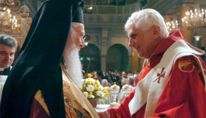 thodox Ecumenical Patriarch Bartholomew and Pope Benedict XVI exchange greetings during a visit to Holy Spirit Cathedral in Istanbul, Turkey, Dec. 1, 2006. (CNS photo/L'Osservatore Romano)