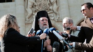 Cypriot Archbishop Chrysostomos II speaks to the media outside the Presidential Palace after his meeting with Cypriot president Nicos Anastasiades, in Nicosia, March 20, 2013. / AP