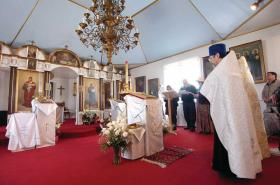 File Photo/Peninsula Clarion Father Thomas Andrew and others bless items inside of the Holy Assumption of the Virgin Mary Russian Orthodox Church in April 2010 before they were transferred to the Kenai Cultural and Visitors Center for a summer art gallery show while the church was being renovated. That project was phase one of the church's three-phase project to completely renovate the church. The church is set to receive $230,000 from the Alaska State Legislature's capital budget that would go toward fire and theft prevention systems, among other items, as part of phase two of the renovations.