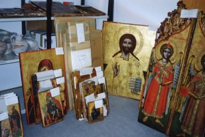 The cache of artworks discovered by Munich police in 1997 included icons, mosaics and frescos stolen from Northern Cyprus and smuggled out of the country after the Turkish invasion. Bavarian authorities returned 173 artworks to representatives of the Cypriot government and Greek Orthodox Church at a ceremony in Munich today. Source: Walk of Truth via Bloomberg