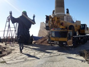 This Oct. 14, 2013 photo provided by the St. Paul's and St. George's Foundation shows workers preparing to install a statue of Jesus on Mount Sednaya, Syria. In the midst of a civil war rife with sectarianism, a 12.3-meter (40-foot) tall, bronze statue of Jesus has gone up on a Syrian mountain, apparently under cover of a truce among three factions - Syrian forces, rebels and gunmen in the Christian town of Sednaya. (Photo: Samir El-Gadban, AP)