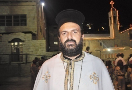 Father Gabriel Nadaf has had to sustain a barrage of criticism over his unorthodox stance on Arab integration | Photo credit: Michel Dot Com