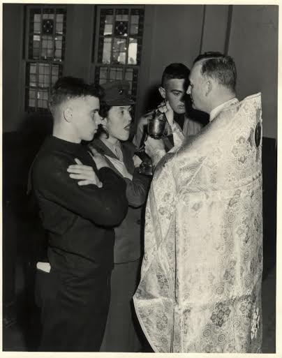 Fr. Boris Geeza [later Bishop Boris] communes US Navy personnel in 1954.