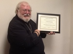The V. Rev. David Randolph receives his certification as a therapist.