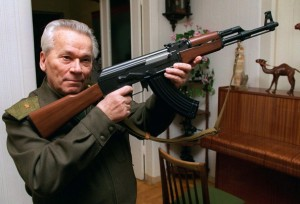 FILE - In this Wednesday, Oct. 29, 1997 file photo Mikhail Kalashnikov shows a model of his world-famous AK-47 assault rifle at home in the Ural Mountain city of Izhevsk, 1000 km (625 miles) east of Moscow. The designer of the world's most prolific firearm, the AK-47 assault rifle, has written a sorrowful letter to the Russian Orthodox Church's head, asking if he's to blame for the deaths of those killed by his creation. According to a Monday, Jan. 13, 2014 report in the daily Izvestia, several months before his death last month at age 94, Kalashnikov wrote to Patriarch Kirill that he keeps asking himself if he's responsible for those deaths. VLADIMIR VYATKIN, FILE / AP PHOTO