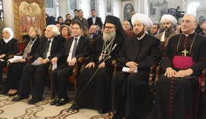 Greek Orthodox Patriarch John X Yazigi of Antioch (front row, 3rd R) sits next to Syria's Grand Mufti Ahmad Badr al-Din Hassoun (front row, 2nd R) at a ceremony to pray for peace, Damascus, Dec. 25, 2013. (photo by REUTERS/SANA)