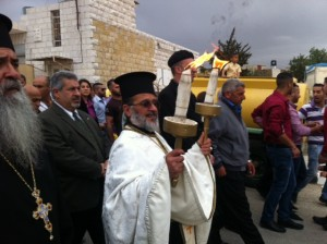 Fr. Daoud Philip Khoury Receiving Holy Fire in the Christian village of Taybeh, Palestine.  Photo: Buthina Khoury