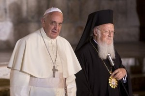 Pope Francis stands with Ecumenical Patriarch Bartholomew I as they meet outside the Church of the Holy Sepulchre (CNS)