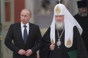 President Vladimir Putin and Patriarch of Moscow and All Russia Kirill arrive for a meeting of Russian Orthodox church bishops in Moscow Feb. 1. - Reuters