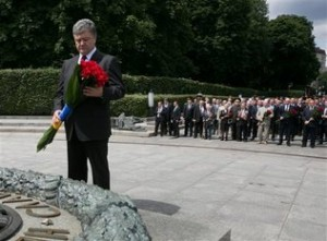 Mykhailo Markiv, Pool - AP Photo Ukrainian President Petro Poroshenko puts flowers on the Eternal flame dedicated to the Day of Memory and grief, surrounding the events of World War II in Kiev, Ukraine, Sunday, June 22, 2014.